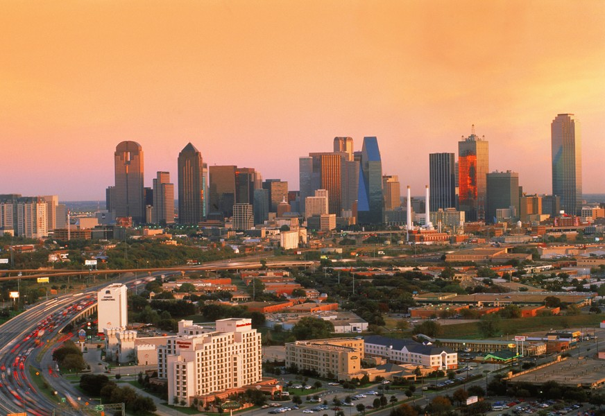 Highway traffic passing around Dallas skyline at dusk (Newscom TagID: scphotos111175) [Photo via Newscom]